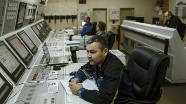 Staff members at the central control post aboard the Akademik Lomonosov, a floating nuclear power plant in Murmansk, Russia.