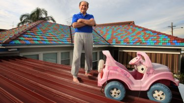 """John Hall painted the roof tiles on his Sans Souci home so his late wife Berta could """"see it better from heaven""""."""