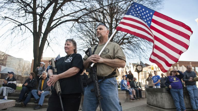 Western Pennsylvania has gone all in for Trump.  National Rifle Association instructor Marilyn Boulet, left, and her husband, Bill Perkins, of Gibsonia, rest their hands on their guns while gathering with other supporters of the Second Amendment outside Pittsburgh.