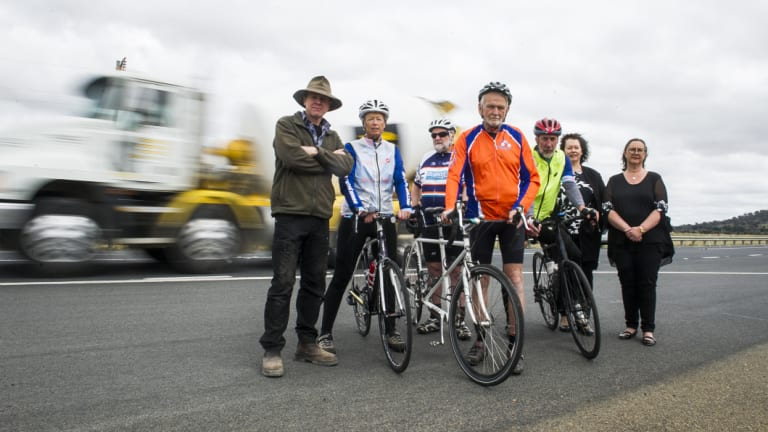 Residents Ross Hampton and Pauline Thorn, cyclists Peter Granleese and Glenn Cocking, John Thorn, Susan Butt and Wendy O'Dea, who are calling for cycle lanes to be included in plans for the Barton Highway duplication.