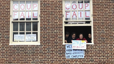 Despite their dwindling numbers and no power, activists vow to stay inside the Venezuelan embassy in Washington.