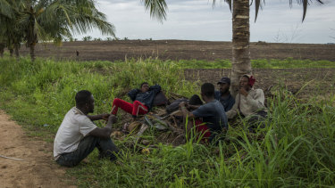 Young workers take a break from farming in Gomoa Mpota, Ghana.