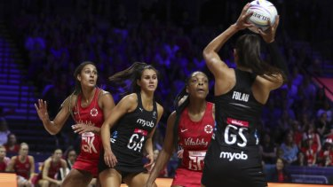 Upset: Maria Folau with the ball for New Zealand against England.