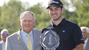 Tournament host Jack Nicklaus presents record-breaker Patrick Cantlay with the trophy.