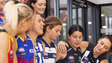 AFLW players attend a launch last year of a four-year broadcast deal with Foxtel and Seven.
