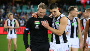 SYDNEY, AUSTRALIA - JUNE 14: Nathan Buckley, Senior Coach of the Magpies celebrates victory with Kade Chandler of the Demons during the round 13 AFL match between the Melbourne Demons and the Collingwood Magpies at Sydney Cricket Ground on June 14, 2021 in Sydney, Australia. (Photo by Jason McCawley/AFL Photos/via Getty Images)