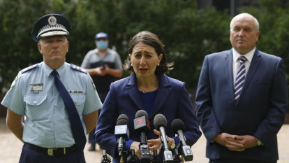 Eighth death, 212 more cases in NSW as government urges people to respect police
