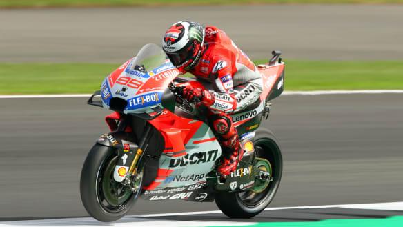 Lorenzo puts Ducati on pole for British MotoGP
