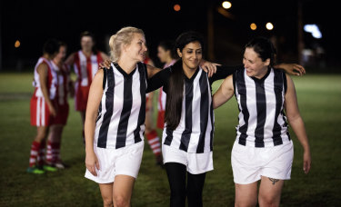 Angela Dalla Rosa (left) with her AFL Masters team members.
