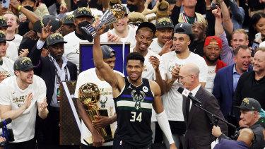 Giannis Antetokounmpo celebrates the Bucks' NBA finals win.