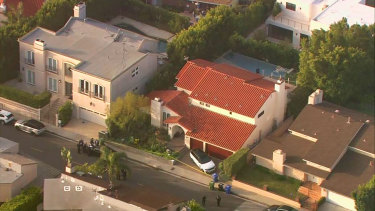 This aerial photo taken from video provided by Fox11 News KTTV-TV shows the Hollywood Hills home where Pop Smoke was shot and killed.