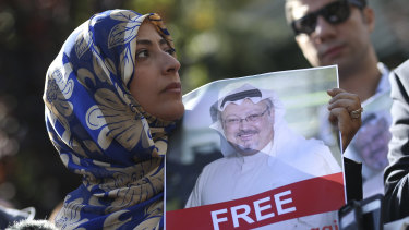Holding a picture of missing Saudi writer Jamal Khashoggi, Tawakkol Karman, the Nobel Peace Prize laureate for 2011, talks to members of the media near the Saudi Arabia consulate in Istanbul, on Friday.