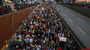 Anti-government protesters march demanding a second round presidential election, in La Paz, Bolivia.