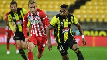 On the burst: Wellington's Roy Krishna streaks ahead of City's Nathaniel Atkinson.