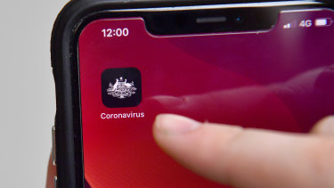 The government's coronavirus tracking app  is demonstrated on an iPhone in Brisbane.