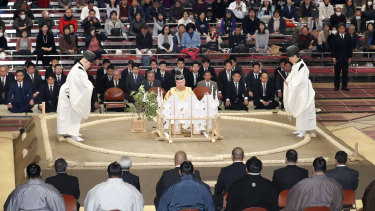 A Shinto ceremony is held to pray for the safety of sumo wrestlers before the start of the Kyushu Grand Sumo tournament in Fukuoka, southwestern Japan.