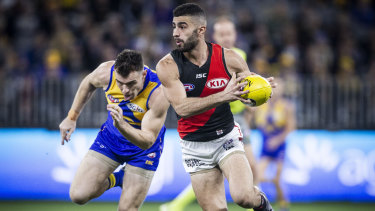 Outpaced: Adam Saad breaks away from West Coast's Luke Shuey in round 14.