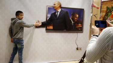 Vladimir Putin's face adorns billboard, souvenir items and television screens everywhere in Russia.