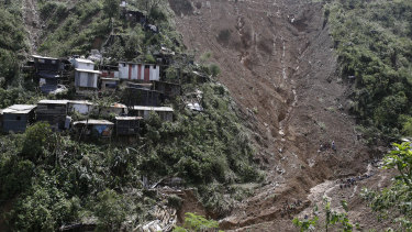 Houses are perched alongside a landslide believed to have buried a number of victims after Typhoon Mangkhut barreled across Itogon, Benguet province, northern Philippines.
