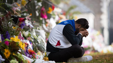 Deepak Sharma mourns at a makeshift shrine at the Botanical Gardens in Christchurch.