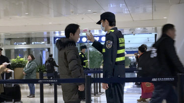 Screening for coronavirus is happening at airports around the world, including in Wuhan.