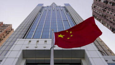 The Chinese flag flutters in the breeze outside China's liaison office building in Hong Kong.