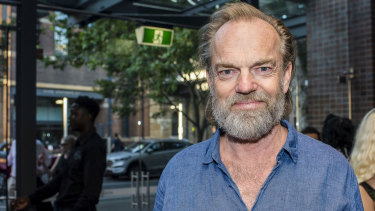 Hugo Weaving dressed in double denim for the theatrical occasion.