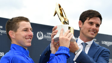 Bluewash: Lane and trainer James Cummins lift the Golden Slipper trophy after Kiamichi's upset win.