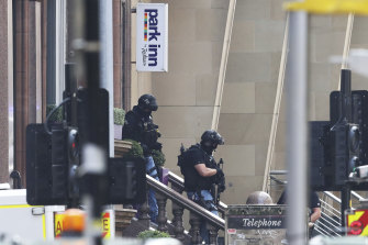 Armed officers outside the hotel.