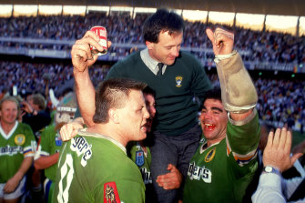 Tim Sheens is hoisted aloft by Glenn Lazarus and Mal Meninga after the 1989 grand final.