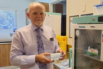 AMAQ councillor Dr Ian Williams with a box of the AstraZeneca doses in his Camp Hill practice on Friday