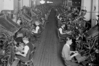 Men operate linotype machines at the Herald.