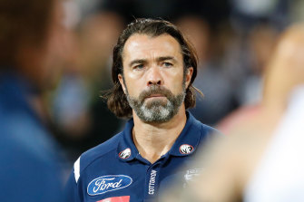 Geelong's Chris Scott says coaches are under enormous pressure, exacerbated by cuts due to the COVID-19 crisis.