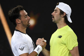Jordan Thompson congratulates Fabio Fognini after their match.