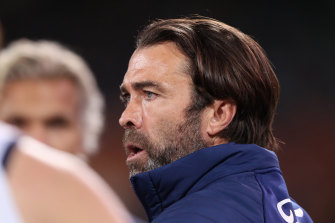 Cats coach Chris Scott was bemused coaches still have to walk through crowds at Adelaide Oval.