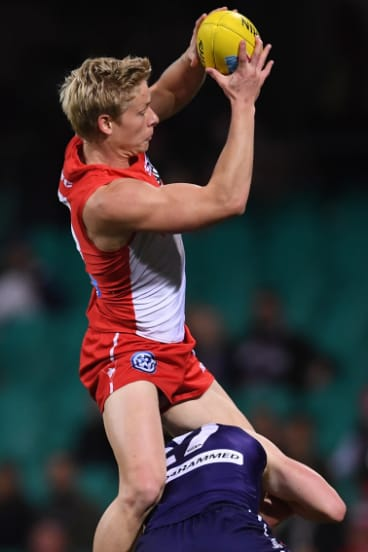 Air time: Isaac Heeney loves taking a big mark.