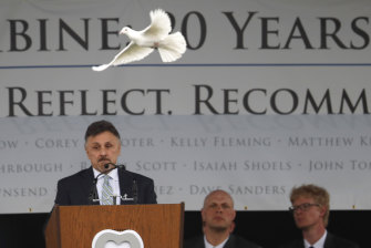 A dove flies over Frank DeAngelis, who was principal of Columbine High School during the attack 20 years ago.