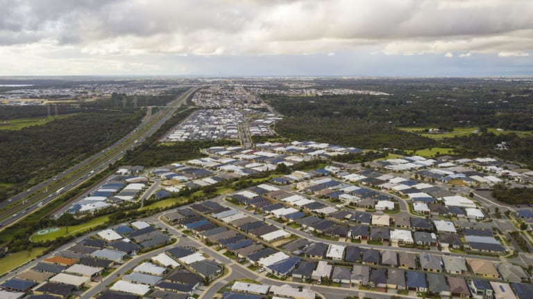 New estates hug the freeways south of Perth.