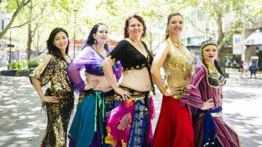 Belly dancers Yukon Okayama, Victoria Leader, Fran Gray, Brooke Thomas and Danika Bertoz prepare for the 2019 National Multicultural Festival.