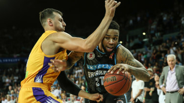 Shawn Long in action against Andrew Bogut last year.