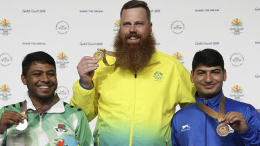 The three medallists, including Shakil Ahmed of Bangladesh (left) and Om Mitharval of India.