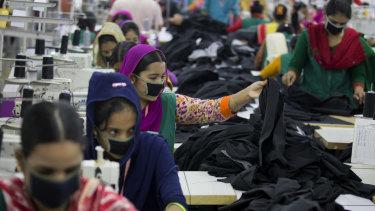 Bangladeshis at work in a garment factory near Dhaka, Bangladesh.