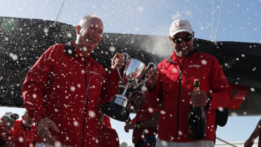 Champagne sailing: Sandy Oatley (left) and Mark Richards hold the J.H. Illingworth Cup for Sydney to Hobart line honours.