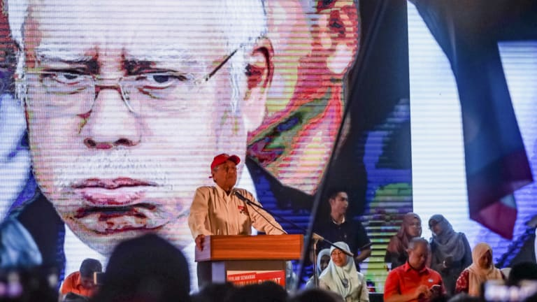 An unflattering image of Prime Minister Najib Razak behind his rival candidate for Malaysia's election, Mahathir Mohamad.