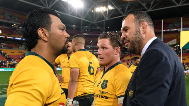 Throwback: Michael Cheika congratulates Kurtley Beale for the win over South Africa – but perhaps not for his mullet.