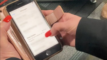 Yvette D'Ath shows journalists her phone as proof she texted Peter Dutton, but she had the wrong number.