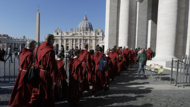 Faithful arrive in St. Peter's Square to attend Pope Francis' Angelus noon prayer at the Vatican.
