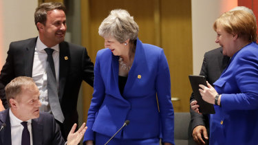 EC President Donald Tusk, left, speaks with British Prime Minister Theresa May, centre, German Chancellor Angela Merkel, right, and Luxembourg's PM Xavier Bettel, second left, prior to a dinner during an EU summit in Brussels.