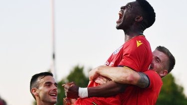 Best on ground: Al Hassan Toure celebrates putting the Reds 1-0 up in the FFA Cup final at Coopers Stadium in Adelaide.