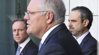 Health Minister Greg Hunt, Prime Minister Scott Morrison and president of the Australian Medical Association, Dr Omar Khorshid, at a COVID press conference in Canberra earlier this year.